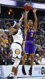 LSU guard Tremont Waters shoots over Michigan State guard Cassius Winston (5) during the first half of a semifinal in the NCAA men's college basketball tournament East Regional in Washington, Friday, March 29, 2019. (AP Photo/Patrick Semansky)
