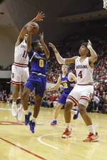 South Dakota State's Brandon Key (0) passes against Indiana's Devonte Green (11) and Trayce Jackson-Davis (4) during the second half of an NCAA college basketball game, Saturday, Nov. 30, 2019, in Bloomington, Ind. (AP Photo/Darron Cummings)