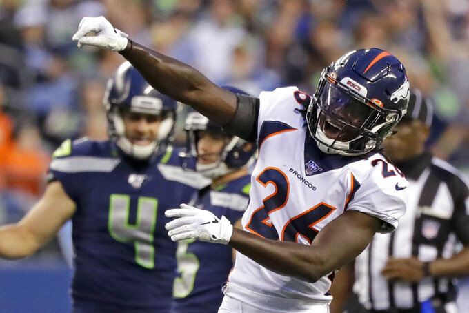 Denver Broncos cornerback Isaac Yiadom reacts after Seattle Seahawks quarterback Geno Smith was sacked by Broncos' Malik Reed during the first half of an NFL football preseason game, Thursday, Aug. 8, 2019, in Seattle. (AP Photo/Elaine Thompson)