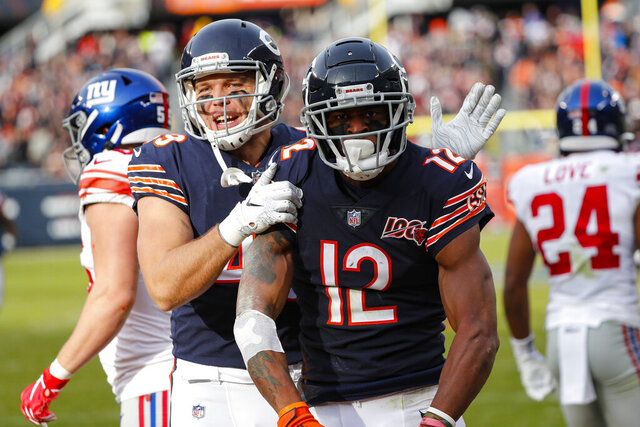 Chicago Bears wide receiver Allen Robinson (12) celebrates his touchdown with Jesper Horsted during the second half of an NFL football game against the New York Giants in Chicago, Sunday, Nov. 24, 2019. (AP Photo/Charles Rex Arbogast)