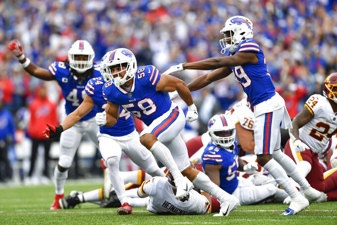 Buffalo Bills outside linebacker Matt Milano (58) celebrates with teammates after sacking Washington Football Team quarterback Taylor Heinicke (4) during the second half of an NFL football game Sunday, Sept. 26, 2021, in Orchard Park, N.Y. (AP Photo/Adrian Kraus)