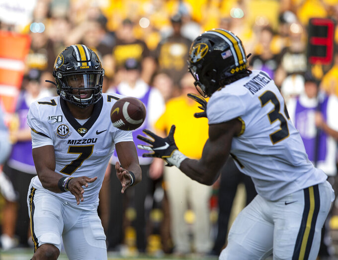 Missouri quarterback Kelly Bryant pitches the ball to Larry Roundtree in the first quarter against Wyoming during an NCAA college football game Saturday, Aug. 31, 2019, in Laramie, Wy. (AP Photo/Michael Smith)