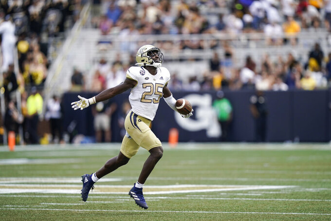Georgia Tech linebacker Charlie Thomas (25) celebrates after making an interception in the second half of an NCAA college football game against Kennesaw State, Saturday, Sept. 11, 2021, in Atlanta. (AP Photo/Brynn Anderson)