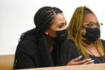 Ashley Sherman, left, wife of free agent NFL football player Richard Sherman, sits with another woman during a hearing about her husband at King County District Court, Thursday, July 15, 2021, in Seattle. Richard Sherman was arrested early Wednesday, police said, after he crashed his car in a construction zone and then tried to break into his in-laws' home in the Seattle suburb of Redmond, Wash. (AP Photo/Elaine Thompson)