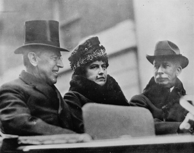 FILE - In this Oct. 11, 1918, file photo first lady Edith Wilson, center, and President Woodrow Wilson, left, arrive in New York to take part in the Liberty Day Parade. Woodrow Wilson was more focused on the end of World War I than a flu virus that was making its way around the globe, ultimately sickening hundreds of thousands of Americans, including him. (AP Photo, File)