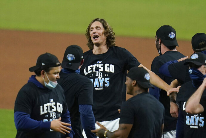 Tampa Bay Rays starting pitcher Tyler Glasnow celebrates after Game 5 of the baseball team's AL Division Series against the New York Yankees, Friday, Oct. 9, 2020, in San Diego. Tampa Bay won 2-1 to advance to the AL Championship Series. (AP Photo/Gregory Bull)