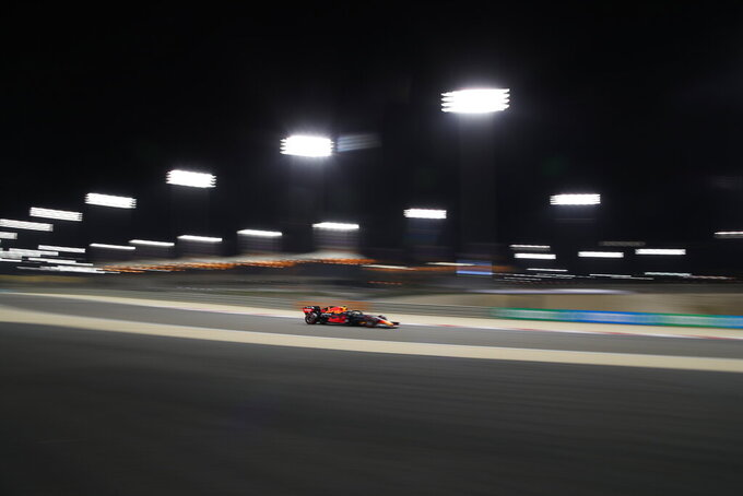 Red Bull driver Alexander Albon of Thailand steers his car during the second free practice at the Formula One Bahrain International Circuit in Sakhir, Bahrain, Friday, Nov. 27, 2020. (Tolga Bozoglu, Pool via AP)