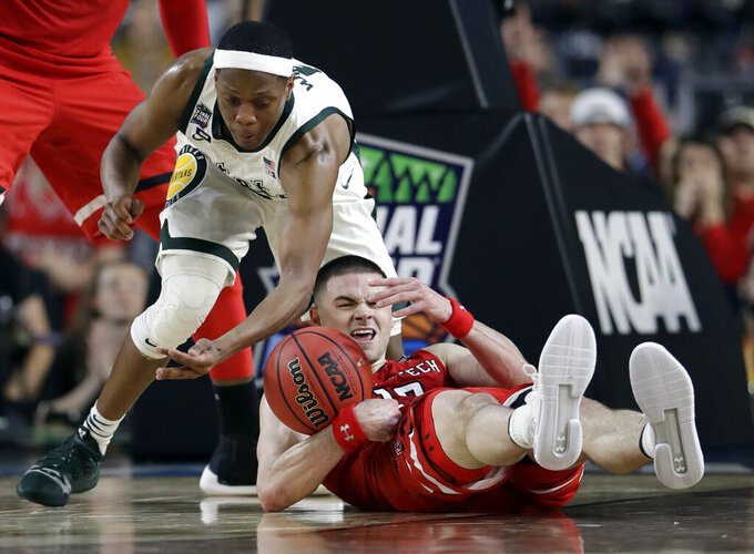 Texas Tech's Matt Mooney (13) battles for a loose ball against Michigan State's Cassius Winston (5) during the second half in the semifinals of the Final Four NCAA college basketball tournament, Saturday, April 6, 2019, in Minneapolis. (AP Photo/Jeff Roberson)