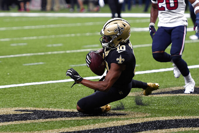 New Orleans Saints wide receiver Tre'Quan Smith (10) pulls in a touchdown reception in the second half of an NFL football game against the Houston Texans in New Orleans, Monday, Sept. 9, 2019. (AP Photo/Bill Feig)