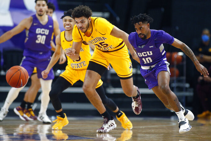 CORRECTS MONTH TO DEC. NOT JAN. - Arizona State forward Taeshon Cherry (35) and Grand Canyon guard Jovan Blacksher Jr. run down a loose ball during the first half of an NCAA college basketball game, Sunday, Dec. 13, 2020, in Phoenix. (AP Photo/Ralph Freso)