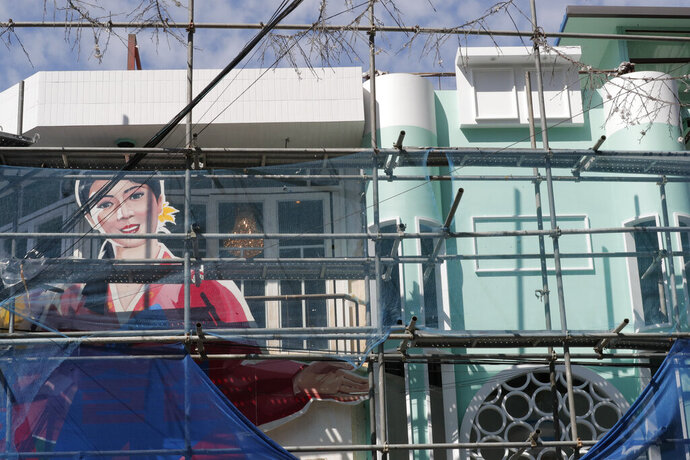 Empty frames, right top and right center, are seen after the removal of the signs with the portrait of North Korean leaders and the image of a North Korean flag from the restaurant's exterior wall of the North Korea-themed restaurant under construction in Seoul, South Korea, Monday, Sept. 16, 2019. North Korea-themed restaurant in Seoul removes Kim portrait and flag image as police look into whether owner violated security law.(AP Photo/Lee Jin-man)