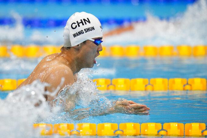 Shun Wang, of China, swims to win the gold medal in the men's 200-meter individual medley final at the 2020 Summer Olympics, Friday, July 30, 2021, in Tokyo, Japan. (AP Photo/Jae C. Hong)