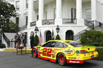 President Donald Trump, center, speaks as he welcomes Joey Logano, left, the 2018 NASCAR Cup Series Champion, to the South Lawn of the White House in Washington, Tuesday, April 30, 2019. Penske team owner Roger Penske, right, also attends. (AP Photo/Susan Walsh)