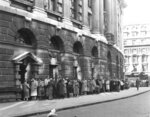 FILE - In this file photo from Oct. 27, 1960, a queue forms outside The Old Bailey Central Criminal Court, in London, for admission to the public gallery where the