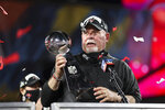 Tampa Bay Buccaneers head coach Bruce Arians holds the Vince Lombardi trophy following the NFL Super Bowl 55 football game against the Kansas City Chiefs, Sunday, Feb. 7, 2021 in Tampa, Fla. Tampa Bay won 31-9. (Ben Liebenberg via AP)