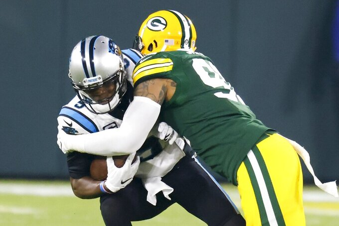 Green Bay Packers' Preston Smith sacks Carolina Panthers' Teddy Bridgewater during the first half of an NFL football game Saturday, Dec. 19, 2020, in Green Bay, Wis. (AP Photo/Matt Ludtke)