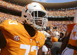 FILE - In this Oct. 14, 2017, file photo, Tennessee offensive lineman Trey Smith (73) makes his way onto the field for the Volunteers' game against South Carolina at Neyland Stadium in Knoxville, Tenn. Smith's own health history gives him all the reason he needed to opt out of the season during the coronavirus pandemic. Yet the preseason All-American is planning to play for the 15th-ranked Volunteers to improve his already high stock for the NFL draft. (C.B. Schmelter/Chattanooga Times Free Press via AP, File)