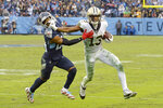 New Orleans Saints wide receiver Michael Thomas (13) pushes past Tennessee Titans cornerback Logan Ryan (26) after Thomas makes a reception in the second half of an NFL football game Sunday, Dec. 22, 2019, in Nashville, Tenn. The catch gave Thomas the single-season pass reception record. (AP Photo/Mark Zaleski)