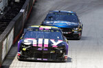 Driver Jimmie Johnson (48) leads Clint Bowyer down the back straight during practice for a NASCAR Cup Series auto race, Friday, Aug. 16, 2019, in Bristol, Tenn. (AP Photo/Wade Payne)