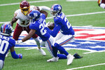 New York Giants cornerback James Bradberry (24) runs back an interception during the first half of an NFL football game against the Washington Football Team, Sunday, Oct. 18, 2020, in East Rutherford, N.J. (AP Photo/John Minchillo)