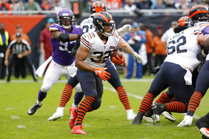 Chicago Bears running back David Montgomery (32) runs with the ball during the half of an NFL football game against the Minnesota Vikings Sunday, Sept. 29, 2019, in Chicago. (AP Photo/Charles Rex Arbogast)