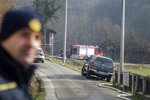 A police officer stands nearby, after a fire at a nursing home, in Andrasevac, northern Croatia, Saturday, Jan. 11, 2020.  A fire engulfed part of a nursing home in northern Croatia early Saturday, killing at least six people, authorities said. (AP Photo/Nikola Solic)