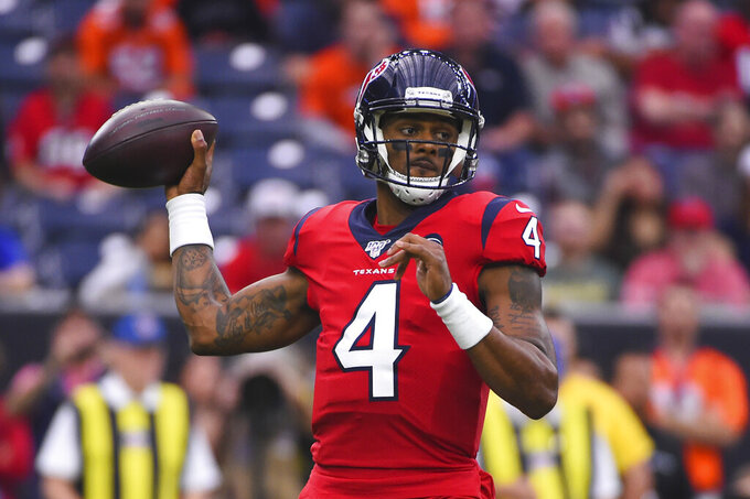 Houston Texans quarterback Deshaun Watson (4) passes against the Denver Broncos during the first half of an NFL football game Sunday, Dec. 8, 2019, in Houston. (AP Photo/Eric Christian Smith)