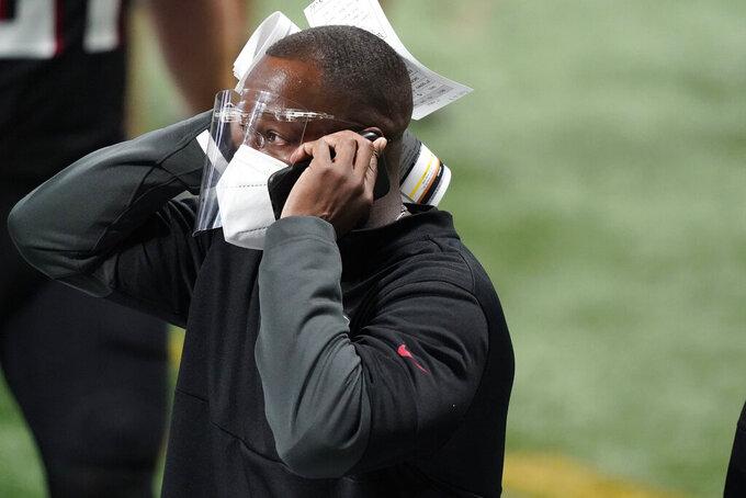 Atlanta Falcons interim head coach Raheem Morris watches play against the Las Vegas Raiders during the second half of an NFL football game, Sunday, Nov. 29, 2020, in Atlanta. (AP Photo/Brynn Anderson)