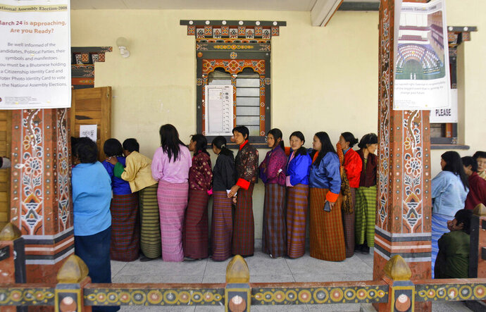 FILE- In this March 24, 2008 file photo, Bhutanese women queue up to cast their votes to select a new parliament and end more than a century of absolute monarchy, in Sisna, on the outskirts of Thimphu, Bhutan. The tiny Himalayan kingdom's lower house of Parliament voted overwhelmingly on Friday to repeal provisions that said