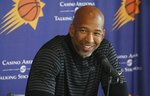 Phoenix Suns head coach Monty Williams smiles as he answers a question about the re-signing of Kelly Oubre Jr. with the Suns NBA basketball team during a news conference Tuesday, July 16, 2019, in Phoenix. (AP Photo/Ross D. Franklin)