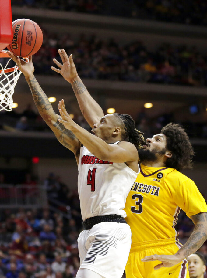 Louisville's Khwan Fore (4) goes for a layup against Minnesota's Jordan Murphy (3) during the first half of a first round men's college basketball game in the NCAA Tournament, in Des Moines, Iowa, Thursday, March 21, 2019. (AP Photo/Nati Harnik)