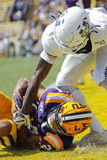 LSU cornerback Derek Stingley Jr. (24) intercepts a pass in the end zone intended for Utah State wide receiver Savon Scarver, right, in the first half of an NCAA college football game in Baton Rouge, La., Saturday, Oct. 5, 2019. (AP Photo/Bill Feig)