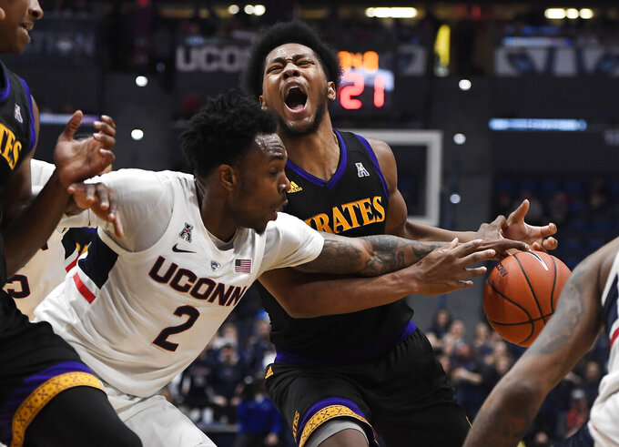 Connecticut's Tarin Smith (2) fouls East Carolina's Jayden Gardner (1) during the first half of an NCAA college basketball game, Sunday, Feb. 3, 2019, in Hartford, Conn. (AP Photo/Jessica Hill)