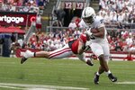 Penn State's Noah Cain gets past Wisconsin's Nick Herbig during the second half of an NCAA college football game Saturday, Sept. 4, 2021, in Madison, Wis. Penn State won 16-10. (AP Photo/Morry Gash)