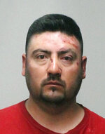 FILE -  This undated file booking photo provided by the Sutter County Sheriff's Office shows Ismael Huazo-Jardinez. Federal immigration officials say Ismael Huazo-Jardinez, a suspected drunken driver charged with plowing into a Northern California trailer home and killing three family members is living in the country illegally. Three family members sleeping in their trailer home were killed and a girl was seriously injured after a suspected drunk driver plowed his pickup truck into the home, police said Monday, May 6, 2019. The California Highway Patrol said Ismael Huazo-Jardinez was driving