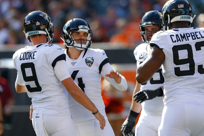 Jacksonville Jaguars kicker Josh Lambo (4) celebrates his field goal in the first half of an NFL football game against the Cincinnati Bengals, Sunday, Oct. 20, 2019, in Cincinnati. (AP Photo/Gary Landers)