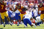 Southern California linebacker Drake Jackson (99) is tackled by San Jose State wide receiver Isaiah Hamilton (9) after catching an interception during the first half of an NCAA college football game Saturday, Sept. 4, 2021, in Los Angeles. (AP Photo/Ashley Landis)