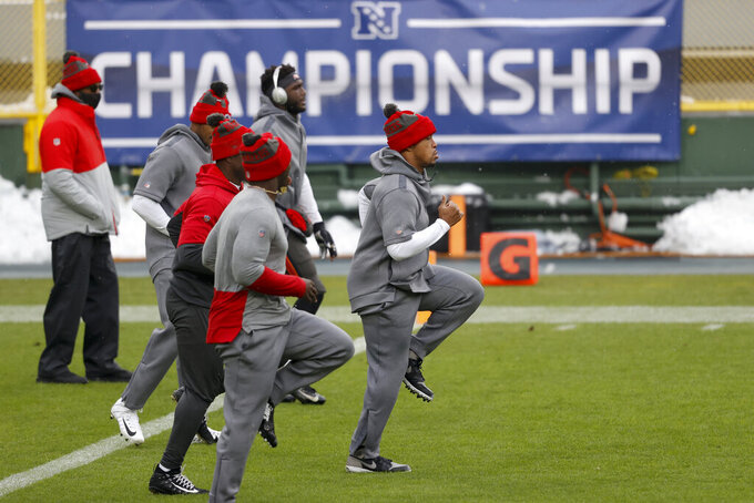 Tampa Bay Buccaneers warm up before the NFC championship NFL football game against the Green Bay Packers in Green Bay, Wis., Sunday, Jan. 24, 2021. (AP Photo/Jeffrey Phelps)