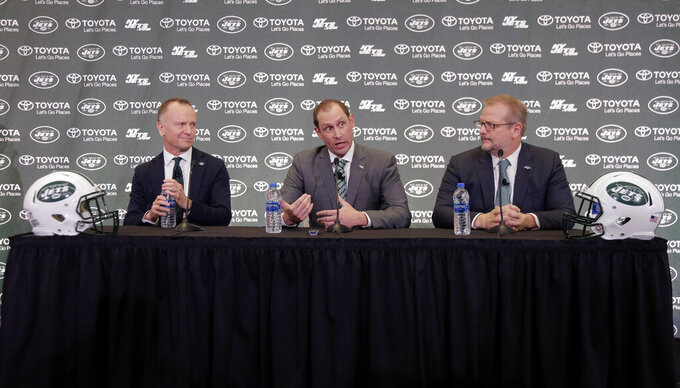 New York Jets head coach Adam Gase, center, speaks while team owner Christopher Johnson, left, and general manager Mike Maccagnan look on during a news conference in Florham Park, N.J., Monday, Jan. 14, 2019. (AP Photo/Seth Wenig)