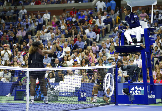 FILE - In this Sept. 8, 2018, file photo, Serena Williams argues with chair umpire Carlos Ramos during a match against Naomi Osaka, of Japan, in the women's final of the U.S. Open tennis tournament in New York. Blown calls, controversial calls and non-calls are nothing new to sports. Sometimes, the reaction of the wronged party can be as memorable as the call itself. (AP Photo/Julio Cortez, File)