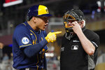 Milwaukee Brewers' Avisail Garcia, left, has some words for plate umpire Brian Gorman after a called third strike in the eighth inning of a baseball game against the Minnesota Twins, Friday, Aug. 27, 2021, in Minneapolis. Garcia was ejected moments later. (AP Photo/Jim Mone)