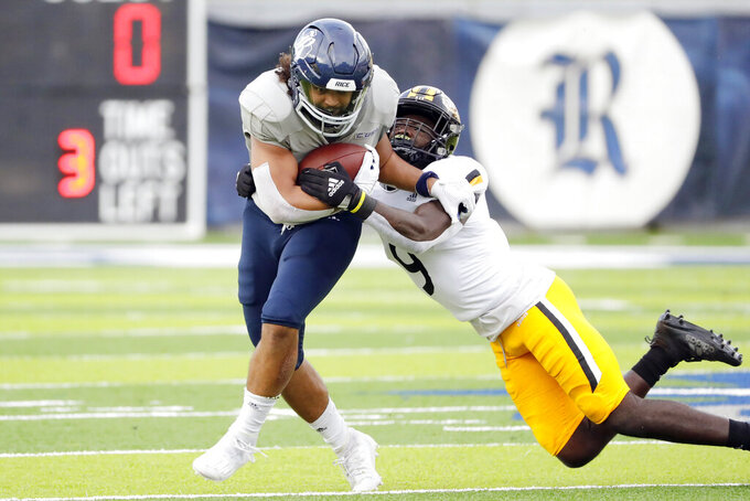 Rice tight end Jordan Myers, left, is caught by Southern Mississippi defensive back Malik Shorts (9) during the first half of an NCAA college football game Saturday, Oct. 2, 2021, in Houston, Texas. (AP Photo/Michael Wyke)