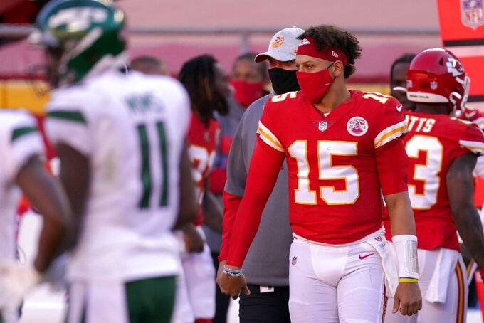 Kansas City Chiefs quarterback Patrick Mahomes (15) greets members and staff of the New York Jets after their NFL football game on Sunday, Nov. 1, 2020, in Kansas City, Mo. (AP Photo/Charlie Riedel)