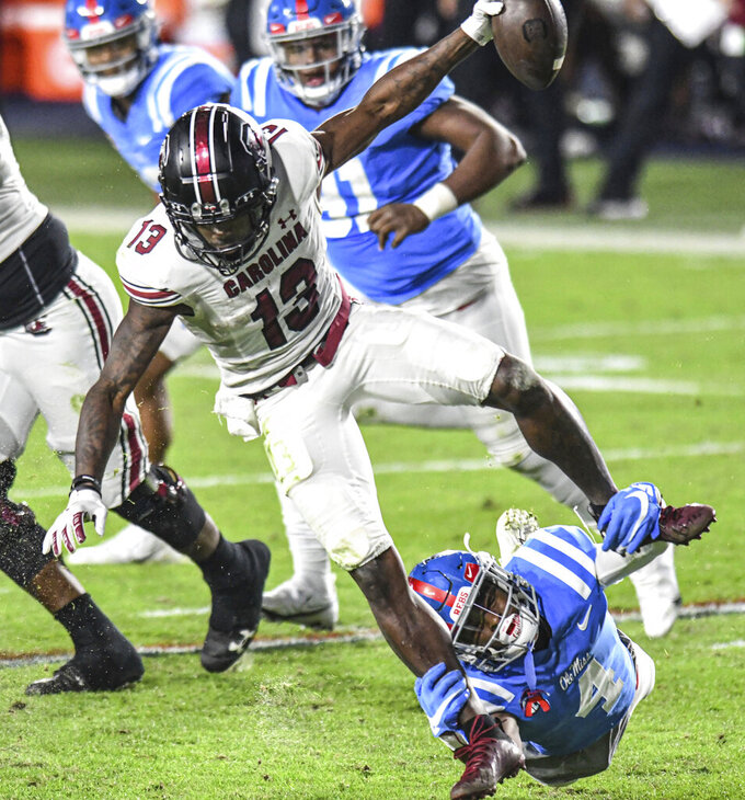 South Carolina wide receiver Shi Smith (13) is tackled by Mississippi defensive back Tylan Knight (4) during the first half of an NCAA college football game in Oxford, Miss., Saturday, Nov. 14, 2020. (AP Photo/Bruce Newman)