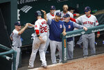 Boston Red Sox's J.D. Martinez (28) fist-bumps coaches and teammates after scoring on Eduardo Nunez's single in the fifth inning of a baseball game against the Baltimore Orioles, Wednesday, June 13, 2018, in Baltimore. (AP Photo/Patrick Semansky)
