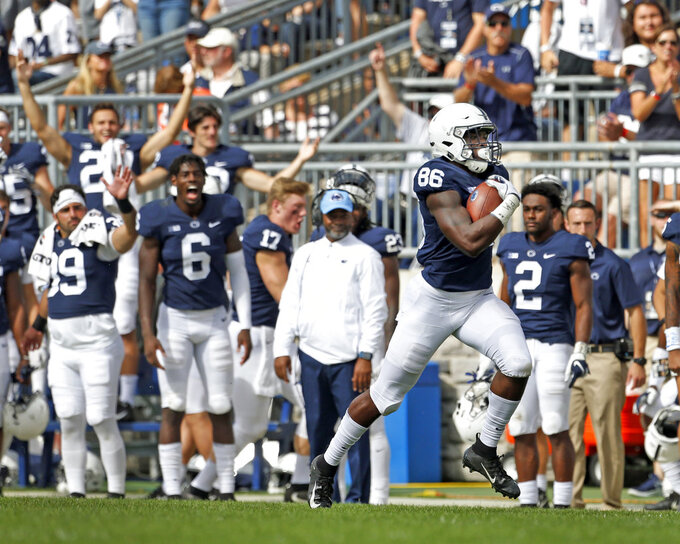 FILE- In this Saturday, Sept. 15, 2018, file photo, Penn State's Daniel George (86) heads to the endzone on for a 95-yards touchdown reception against Kent State during the second half of an NCAA college football game in State College, Pa. Traditional Big Ten powers Wisconsin, Michigan and Michigan State have lost out-of-conference games. There are only five unbeaten teams remaining in the conference, and that number seriously might be down to one at the end of the month after No. 4 Ohio State plays at No. 10 Penn State. Slow starts, however, doesn't mean the conference is out of the national title hunt.  (AP Photo/Chris Knight, File)