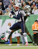 FILE - In this Nov. 25, 2018, file photo, New England Patriots' Stephon Gilmore (24) intercepts a pass to New York Jets wide receiver Robby Anderson (11) during the first half of an NFL football game Sunday,, in East Rutherford, N.J. Gilmore earned All-Pro honors for the first time in his career and taken the leadership reins of a secondary that lost Malcolm Butler in free agency this past offseason.  (AP Photo/Bill Kostroun, File)