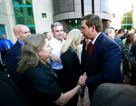 Florida Gov. Ron DeSantis, right, shakes hands with supporters and family members of the Parkland, Fla., shooting, after speaking at the Broward County Sheriff's Office Fort Lauderdale headquarters, Friday, Jan. 11, 2019, in Fort Lauderdale, Fla. DeSantis suspended Broward County Sheriff Scott Israel on Friday over his handling of February's massacre at Marjory Stoneman Douglas High School. (AP Photo/Wilfredo Lee)