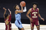 Rhode Island's Fatts Russell shoots between Boston College's Makai Ashton-Langford, left, and DeMarr Langford Jr. during the second half of an NCAA college basketball game Thursday, Nov. 26, 2020, in Uncasville, Conn. (AP Photo/Jessica Hill)