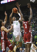 Oregon's Louis King, center, goes up for a shot against CJ Elleby, left, and Robert Franks Jr., right, during the first half of an NCAA college basketball game Sunday, Jan 27, 2019, in Eugene, Ore. (AP Photo/Chris Pietsch)